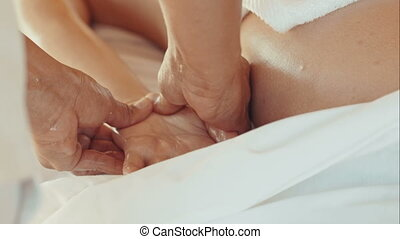Massage of palm and fingers in beauty spa - Close-up of...