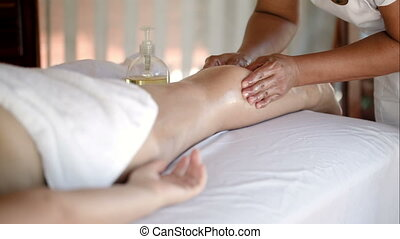 Woman getting massage treatment in beautiful spa
