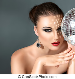 Woman with disco ball - Close-up face of young woman with...