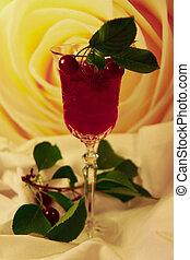 cherry and glass of wine - is the glass of wine and a sprig...