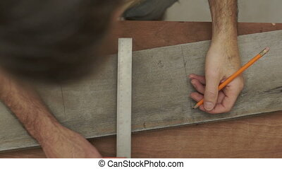 Carpenter Marking Wood Overhead - Close up overhead shot of...