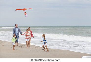Family Parents Girl Children Flying Kite on Beach - Happy...