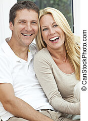 Happy Middle Aged Man and Woman Couple Laughing