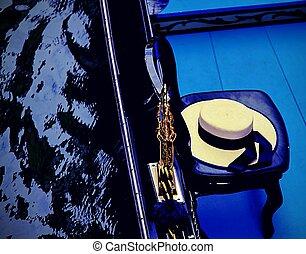 Venetian gondolier's hat on a gondola in Venice