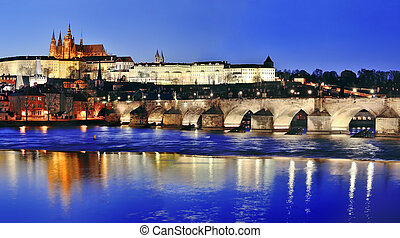 Charles Bridge (Karluv Most) and Vltava river by night,...