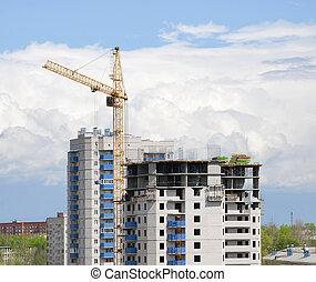 Crane on a building area - building area