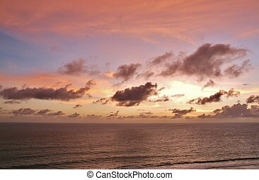 Amazingly colorful sea beach sunset with reflective red sand...