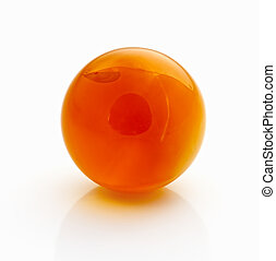 Amber spheres on a white table Baltic sea