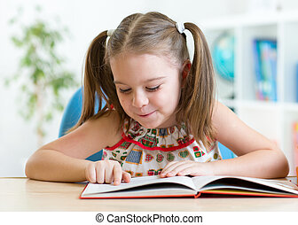 education concept - little student kid reading book