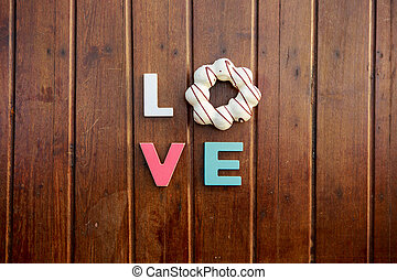word love on the wooden table - word love made up of...