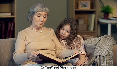 Happy End - Portrait of granny finishing reading to her...