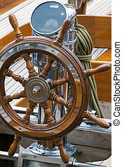 Steering wheel - Detail of a wooden steering wheel on a...