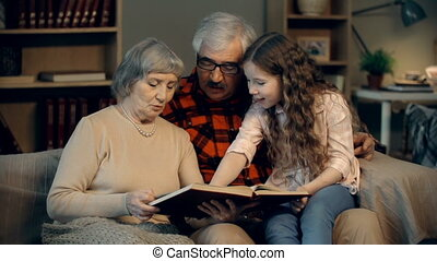 Picture Dictionary - Family of three looking through the...