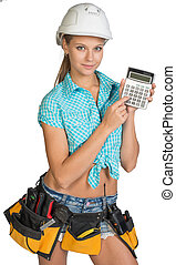 Woman in hard hat and tool belt showing calculator