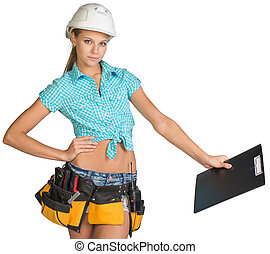 Woman in hard hat and tool belt holding clipboard