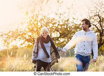 Happy couple - Happy young pregnant couple spending time...