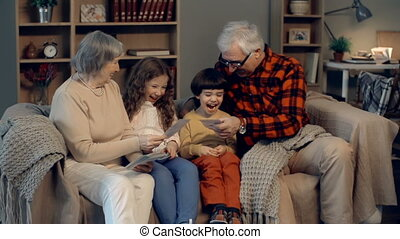 Memory Lane - Family of four looking through the collection...