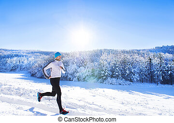 Man jogging in winter nature - Young sportsman jogging...