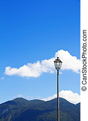 Street light - Old vintage street light against blue sky