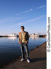 Young man waiting on a pier