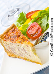 Bacon quiche with salad on a plate