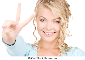 victory - bright picture of lovely blonde showing victory...