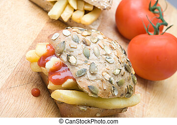 Chip sandwich - Chips in a wholemeal bread bun with ketchup