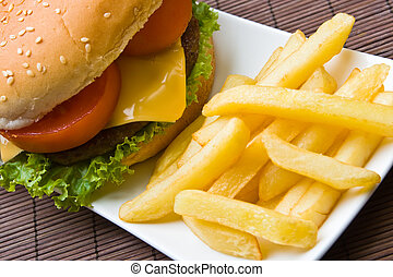Delicious beefburger with french fries