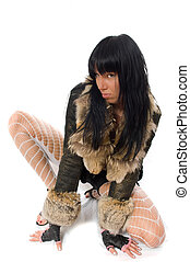 sexy young babe in fur coat isolated