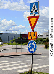 road signs at intersection roundabout