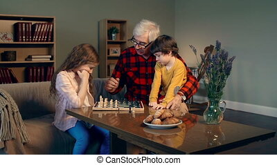 Logical Thinking - Dolly in of children playing chess with...