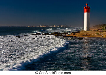 Umhlanga Lighthouse with Durban cityscape as background