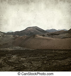 textured old paper background with landscape of Timanfaya...