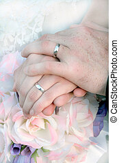 Bride and Groom Rings - Bride and grooms hands and rings...