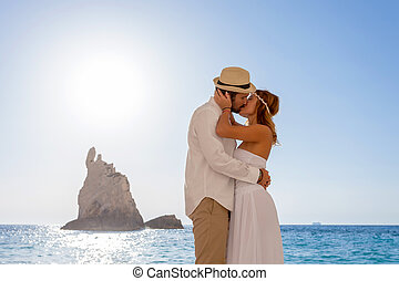 bride and groom at the beach - portrait of a beautiful young...