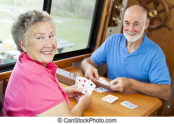 RV Seniors - Playing Cards - Happy retired couple playing...