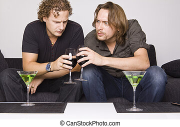 two friends drinking at home