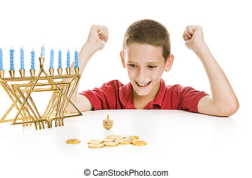 Boy Spinning the Chanukah Dreidel - Cute little boy on...