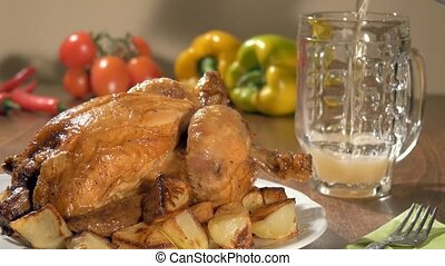roast chicken and pouring beer - a table spread with roast...