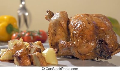 roast chicken with baked potatoes o - a table spread with...