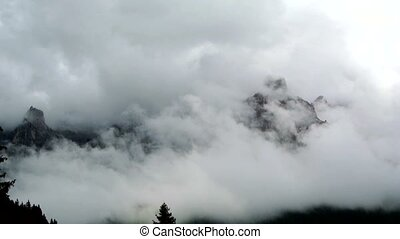 Clouds through the mountains Pale di San Martino, Dolomites...