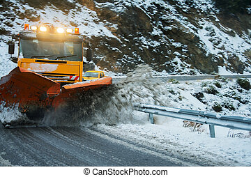 Snow plough moving snow on a dangerous bend after a snow...