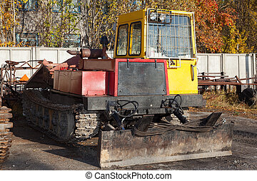 tracked skidder standing in the parking lot of repair...