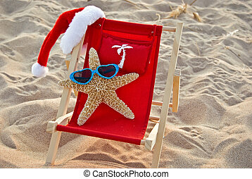 Happy Holiday - Santa starfish lounging in a beach chair.
