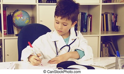 Child writing medicine prescription - Happy kid having fun...