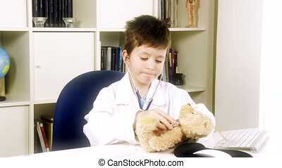 doctor child visiting teddy bear - Happy kid having fun...