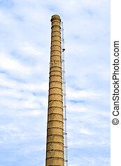 smokestack in the blue sky