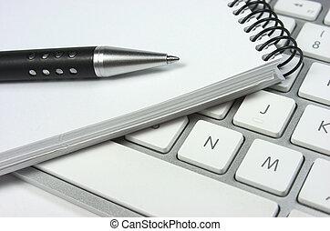 Computer keyboard. Idea. Notepad - Computer keyboard, pen...