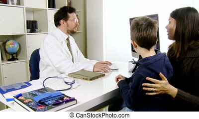 Doctor talking to child and mother