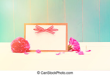 Card with carnations on teal colored wood - Blank card with...